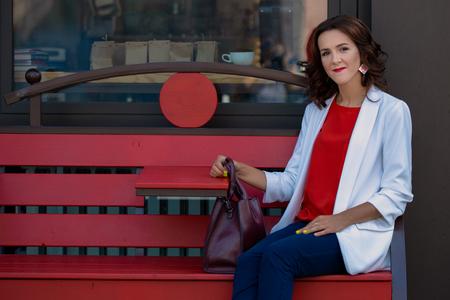 Portrait of a beautiful stylish business woman outdoors Фото со стока