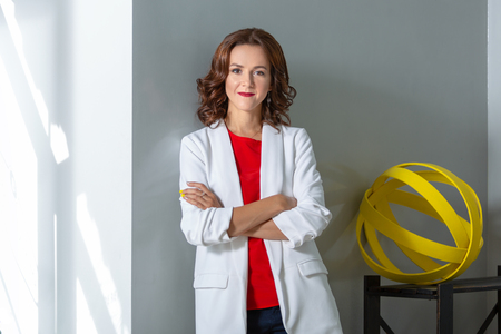Portrait of a beautiful business woman. Photo in the room Фото со стока