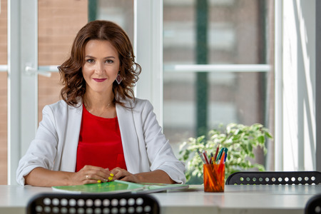 Portrait of a beautifu successfull business woman in the workplace