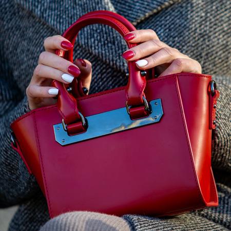 Red ladies handbag closeup. Fashion accessory