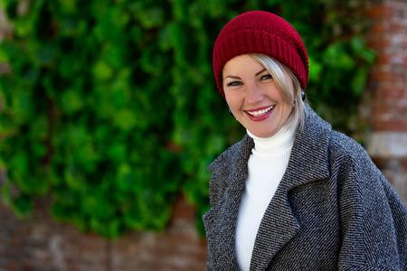 Portrait of a beautiful cheerful woman outdoors Фото со стока