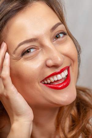 Smile. Portrait of a beautiful young woman. Female face close up Фото со стока