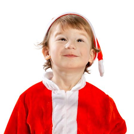 Little Santa. Portrait of a child in a suit. Christmas
