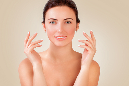 Portrait of a beautiful young smiling woman. Womens hands Imagens