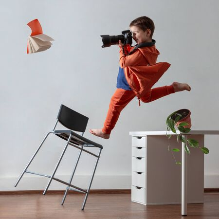 Young photographer. A child with a camera in his hands. Collage
