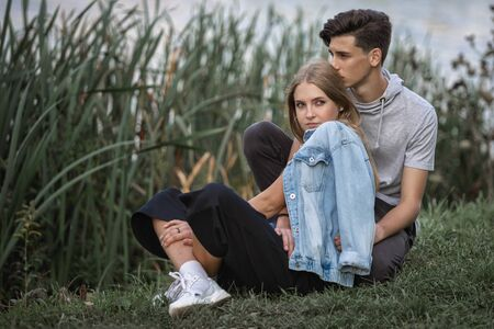 Portrait of a beautiful young couple in love. Teenagers Man and woman outdoors Imagens