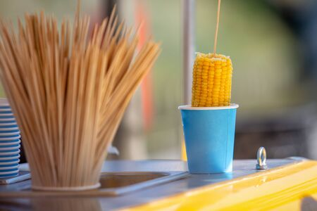 Boiled corn in a glass. Outdoor photo
