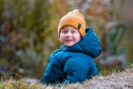 Portrait of a child outdoors. Happy little boy