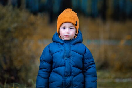 Portrait of a child outdoors. Boy in nature Imagens