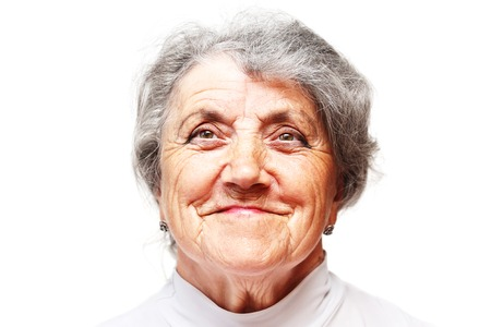 congenial: Gracious senior lady portrait on white background