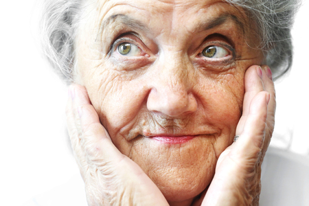Old woman face with hand on white
