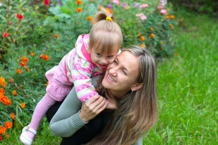 Happy Mom and daughter in the garden