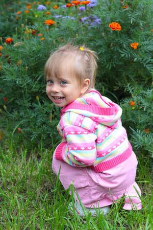 Little Girl in garden Stock Photo