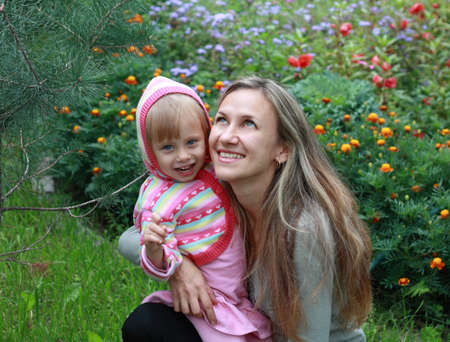 Happy Mom and daughter in the garden  Stock Photo