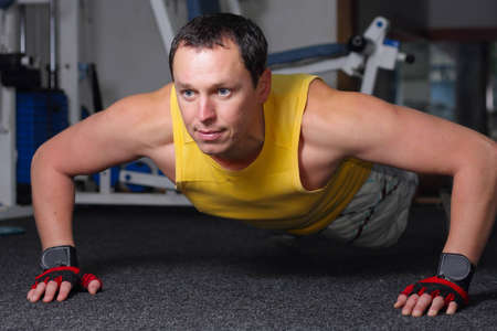 Man training in fitness center photo