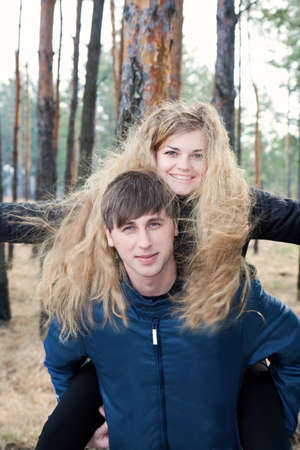 beautiful young couple smiling together in forest Stock Photo - 9096253