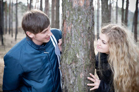 beautiful young couple smiling together in forest Stock Photo