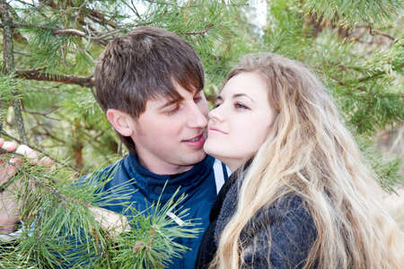 Closeup portrait of a beautiful young couple smiling together photo