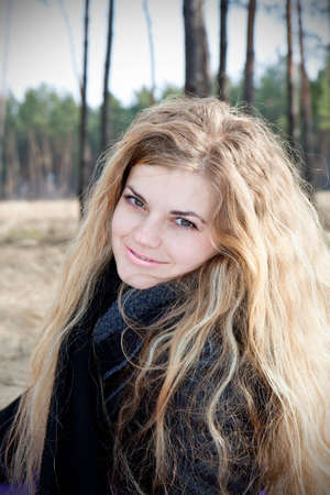 beautiful, happy a girl outdoor in forest photo