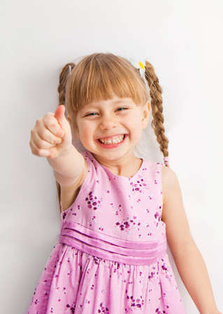 pigtail: a little girl reaching for something with his hands.