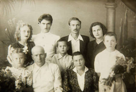 old photograph: An old photo which shows a family