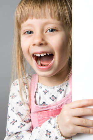 A studio portrait of a girl laughing Stock Photo