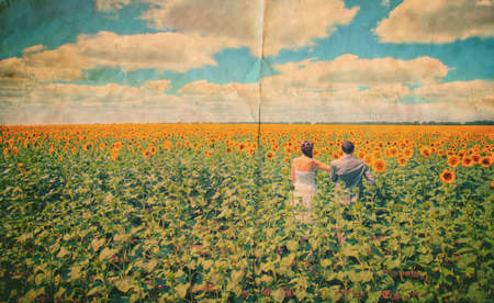Young love Couple  in sunflowers photo