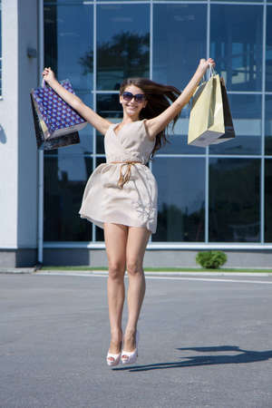 Happy girl with shopping on the street  Stock Photo
