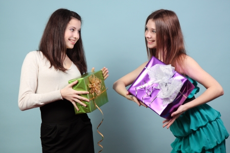A beautiful girl holding gifts