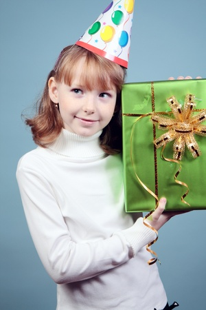 Beautiful charming girl with a gift. Stock Photo