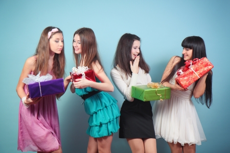 Group of cheerful, happy girl with gifts. Stock Photo