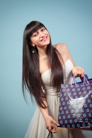 Happy, attractive girl with purchases. Stock Photo