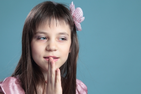 Portrait of the girl on a blue background Stock Photo