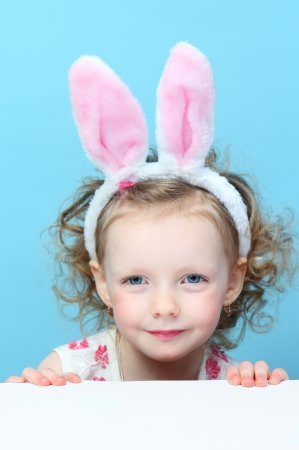 Little , fun girl with bunny ears
