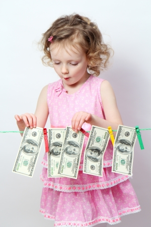 Funny little girl with money photo