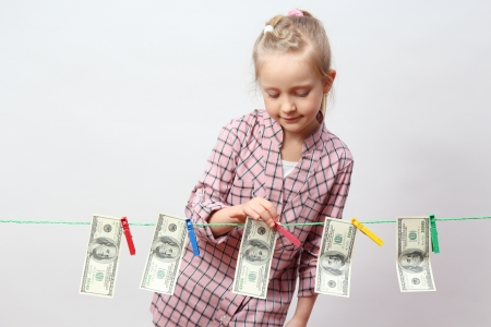 Funny little girl with money
