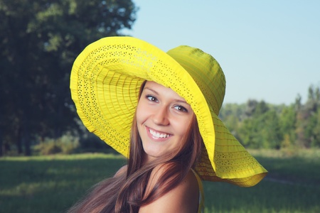 Beautiful girl in a hat on the nature  Stock Photo