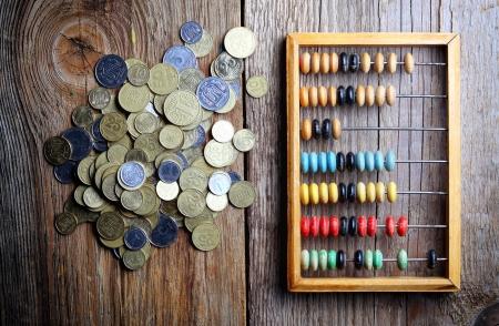 wooden bills coins photo