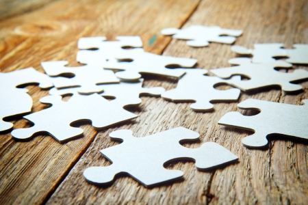 puzzles on a wooden  Stock Photo