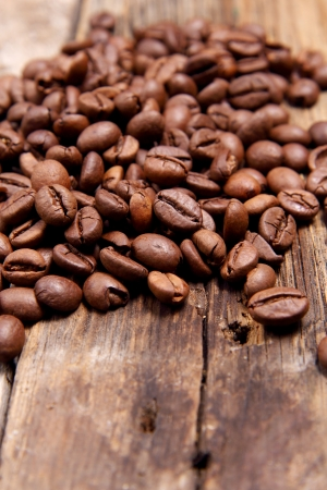 coffee beans on wooden table Stock Photo