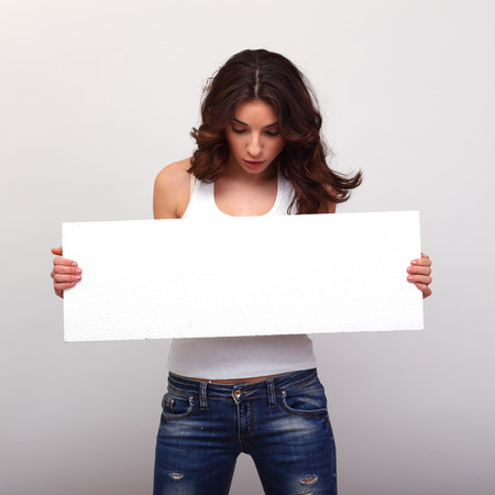 Girl holding blank white copyspace. photo