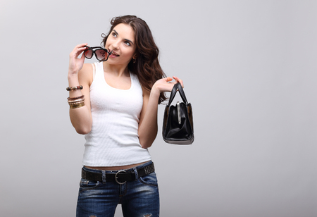 Young beautiful girl in glasses whith bag. photo