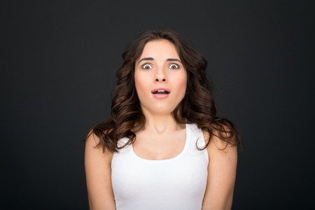 amazed: Young woman surprised