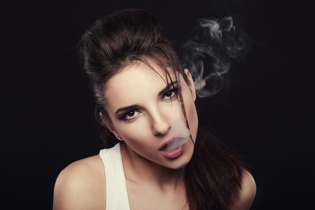 hot sexy girls: Girl producing cigarette smoke