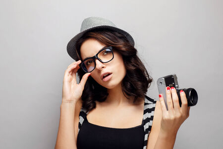 Beautiful attractive girl in a hat with camera. Stock Photo