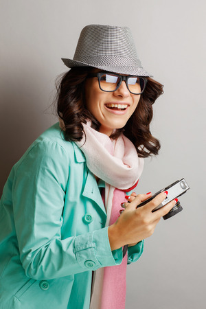 Beautiful girl in a hat taking pictures on the camera. Stock Photo
