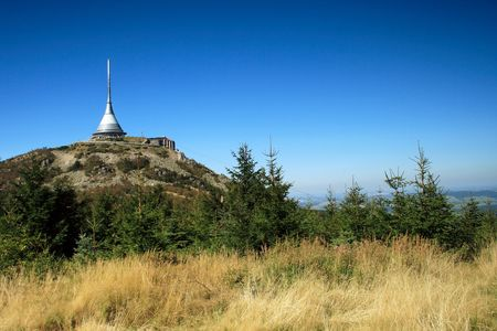 TV transmitter with restaurant on a mountain top photo