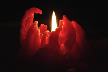 red candle light with black background photo