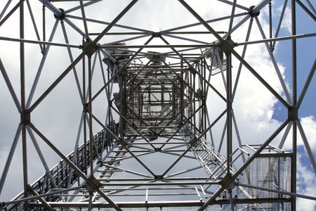 metal structure: metal structure of antenna mast under sky with clouds Stock Photo