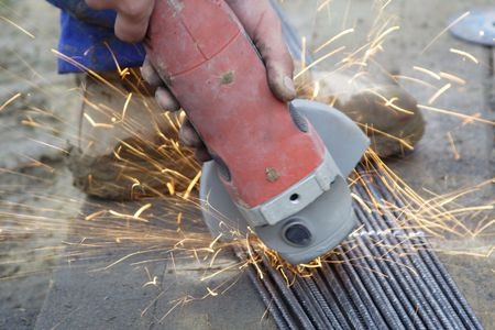 cutting steel wires with grinding machine photo
